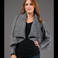 Striped Cardigan A touch of flirty feminine style to your wardrobe with this whimsical design by Willow & Clay. 50% acrylic, 35% nylon & 15% mohair. Willow & Clay Sweaters Cardigans