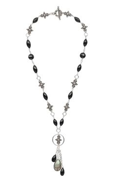 "Sterling silver links alternate with faceted black spinel beads in this elegant, classic ""Y"" necklace. A labradorite drop adds sophisticated shimmer.  Jewelry Design - Single-Strand Necklace with Sterling Silver Links, Black Spinel and Labradorite Gemstone Beads - Fire Mountain Gems and Beads"