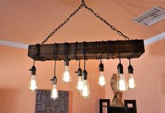 Farmhouse chandelier - Rustic lamps including light equipment which is decorated with pinecones, animal antlers, trees, fish, or fishing. It can enhance the decor of a country cottage or farmhouse. Chandelier Design, Wooden Chandelier, Farmhouse Chandelier, Farmhouse Lighting, Pendant Chandelier, Rustic Lighting, Chandelier Lighting, Unique Chandelier, Iron Chandeliers