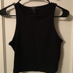 Forever 21 Black Ribbed Crop Tank - Sz M Black ribbed crop tank by Forever 21. U-neck. Lightly worn. Good condition. Forever 21 Tops Crop Tops