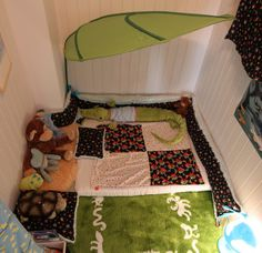 Tavi's new bed... no way to fall out of the bed when it's on the floor!