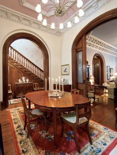 Impressive Classic Mansion Design Seems Artistic with Unusual Ornament : Fabulous Dining Room With Glossy Wooden Table And Fabric Upholstery...