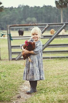 this little girl reminds me of me! I was always playing with our chickens :)