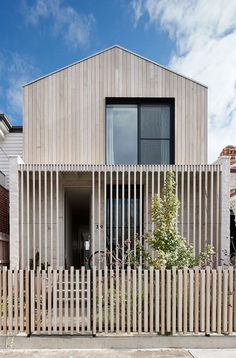 As a contemporary terrace house for a young family in Brunswick, LLLBion House by Tecture has been designed as a home filled with love and laughter. Residential Architecture, Modern Architecture, Halls, Backyard House, Suburban House, Timber Cladding, Wood Cladding Exterior, House Cladding, Timber Fencing