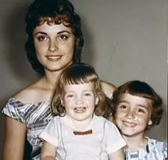 Sharon Tate with her three sisters. On her lap is Patti Tate, and next to her is Debra Tate. 1950's