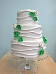Modern Wedding Cake- with different colored flowers... blues, maybe... or something brighter