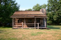 Photo about A log cabin in a rural or country setting. Image of vintage, cabin, yesteryear - 7934462 Vintage Cabin, Outdoor Gardens, Townhouse, Lawn, Retail Logo, Stock Photos, House Styles, Modern, Houses