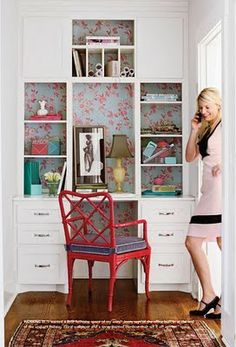 Jenny Keenan hallway built-in desk, red fretwork chair, red/blue wallpapered built-ins