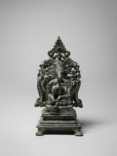 Ganesha India, Karnataka Western Chalukya period, 10th century Copper alloy Height: 5 3/8 in. Atop a lotus on a high, footed and tiered pedestal, Ganesha sits in the relaxed lalitasana, his extended right foot almost touching the lively rodent mount who looks up at his master. Is he eager for a morsel of the sweetmeat (laddu) that Ganesha holds in his lower left hand and is about to pick up with his proboscis? Provenance: Siddharth K. Bhansali Collection, Shri Ganesh, Lord Ganesha, Chola Dynasty, Sculptures, Lion Sculpture, Indian Architecture, Hindu Art, South India, Sacred Art
