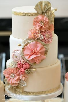 Floral cascade wedding cake in tender shades of blush coral and pink by the Sophie Bifield Cake Company. Sophie's ruffled flower tutorial http://www.facebook.com/notes/sophie-bifield-cake-company/how-to-make-a-ruffled-gumpaste-flower/364943683532727