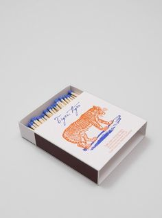 beautiful match box with tiger poem illustrated cover