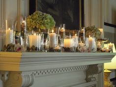 candles on the mantel, orchids and hydrangeas