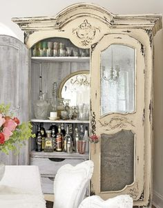 "I could make a version like this one day! Antique white patina bar armoire with mercury glass front door panels....the antique white is a little too ""shabby sheik"" for my taste but love the idea"