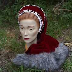 A Tudor French hood inspired by the story of Red Riding Hood.