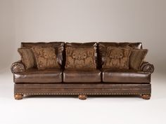 Ashley Chaling DuraBlend 9920038 Signature Design Antique Sofa - With the thick rolled arms and supportive seating and back cushioning, this furniture collection adds a deep comfort perfect for any living environment<br />