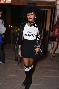 "black leather jacket + white and black ""wild feminist"" shirt + black mini skirt + black and white knee high socks + black boots"