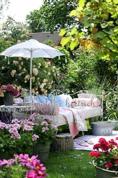 Ah, I can just feel the summer breeze... smell the roses and feel the suns warmth! :)  Have the bed... now just need the flowers and shrubs!!! :)