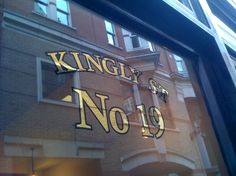 23 carat Gold leaf gilding on a glass door in London