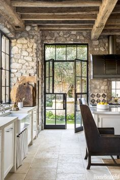 amazing original stone walls and huge glass doors 27 Best Rustic Wall Decor Ideas to Transform Worn-out right into Fabulous #RusticWallDecor #WallArt #WallDesign #AccentWallIdeas  #HomeDecorIdeas #HouseIdeas #FarmhouseDecor #RusticHomeDecor #DiyHomeDecor