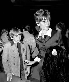 "Audrey Hepburn Dotti photographed with her son Sean at the Sistina Theatre in Rome, April 1970. Audrey wears a Givenchy blouse (""chemise style"") and pants of black silk jersey, with collar and cuffs of white silk, from Givenchy's haute couture collection for the Spring/Summer of 1970."
