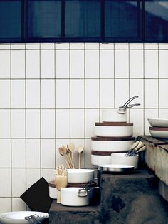 Shiny ceramic bowls with heavy wooden lids. Kitchen.