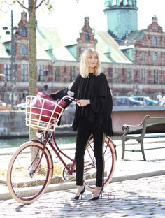 In a chic black outfit, the bike's beautiful colors become the centerpiece.
