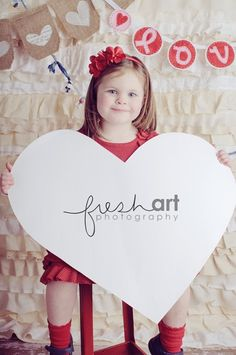 valentines day photo idea - have the kid hold a blank heart cutout and then they can sign their name to the print to give to their friends. (from fresh art photography in st louis)
