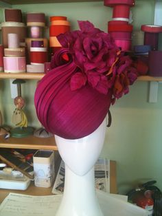 Magenta fascinator with a hint of orange in silk abaca. louise Macdonald Milliner