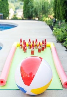 Do it Yourself Outdoor Party Games {The BEST Backyard Entertainment DIY Projects} : DIY Projects - Outdoor Games - DIY Bowling Game with Coke Bottles a yoga mat - pool noodle bumpers and a beach ball - fun Tutorial via The Polka Dot Chair Pool Party Games, Pool Party Kids, Outdoor Party Games, Kid Pool, Pool Party Activities, Pool Noodle Games, Beach Ball Party, Outdoor Activities, Pool Party Decorations