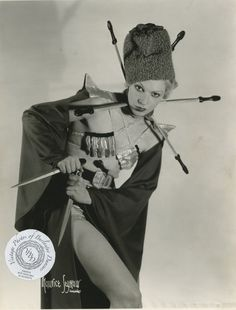 mudwerks:    burlyqnell:    Mademoiselle Bettie: vintage 8x10 photo from a 6 October 1936. I am guessing Bettie may have been a knife thrower, but I have not been able to find any information on her.     pointy…