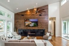 Looking for Neutral Contemporary Living Space ideas? Browse Neutral Contemporary Living Space images for decor, layout, furniture, and storage inspiration from HGTV. Fireplace Redo, Living Room With Fireplace, Fireplace Ideas, Granite Fireplace, Wood Panel Walls, Wood Paneling, Tv Walls, Wooden Accent Wall, Wall Wood