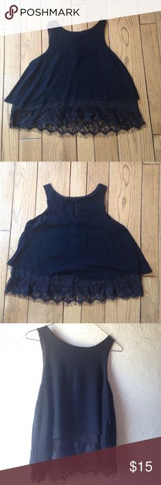 Black tank top with lace This black tank top has an adorable lace detailing on the bottom and a button on the back. It is in excellent condition!! Paper Crane Tops Tank Tops