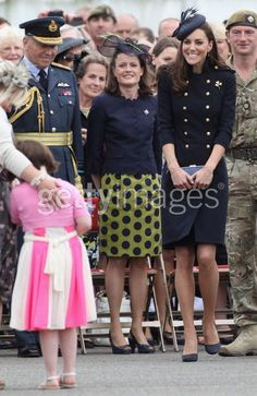 Catherine, Duchess Of Cambridge. HRH, here, is putting the little girl at ease.