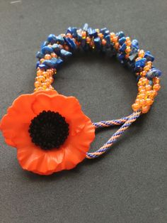 Kumihimo bracelet I designed w/lapis chips & beautiful sunflower button.
