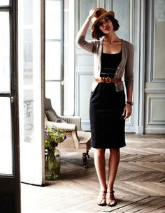 Simple, classic black dress with cardigan and belt.