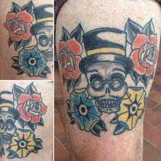 Skull flowers tattoo