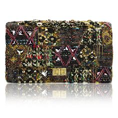 Chanel Paris Byzance Classic Bag Outstanding Pieces collection. This iconic flap bag is re-imagined in multi-colored tweed patchwork, embroidered with beads, chains and cabochon bijoux and polished off with a Mademoiselle lock. Leave it to Karl Lagerfeld to prove that gilding the lily can be a very good thing.    $10,000
