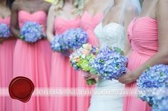 Pretty bridesmaids all in a row with a pop of bride in the middle shows off bouquets by June Sweeny....