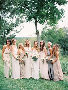 Libby's favorite bridesmaid look--floral print for MOH . . . Gorgeous mismatched bridesmaids!! Backyard Austin Wedding by Taylor Lord You have to click on this picture to see another picture or two that shows there seems to actually be about 6 more maids in this bridal party with even more varying shades/styles on the mismatched theme!