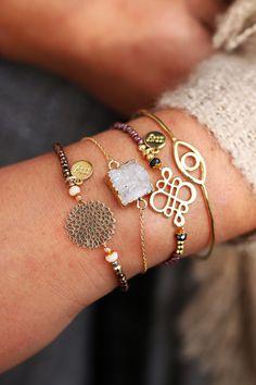 Beautiful golden armparty with gold bracelets, natural stone bracelets…