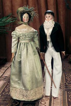 German Paper-Mache Dolls Germany, circa 1840. Fine soft silk antique gown and undergarments, early bonnet.