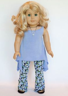 Periwinkle twirly tunic top with floral wide leg pants outfit by EverydayDollwear. Made with the Twirly Tunic pattern, found at http://www.pixiefaire.com/products/twirly-tunic-18-doll-clothes. #pixiefaire #twirlytunic