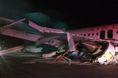 03/29/2015 - IN PHOTOS: Air Canada plane skids off runway at Halifax airport