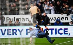 The excitement got the better of one Newcastle supporter, who slipped while running onto the pitch to celebrate a goal by Aleksandar Mitrovic who had to take an evasive leap