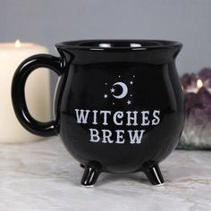 Witches Brew Mug This brilliant black mug is designed to look like a cauldron and features the words 'Witches Brew'. This brilliant black mug is designed to look like a cauldron and features the words 'Witches Brew'.