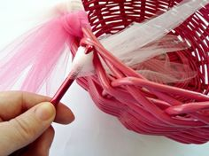 Use a crochet hook to pull tulle