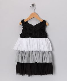 Perfectly precious, this darling dress features a crushed flower bodice, tiers of tulle and a back ribbon tie. In this easy-on frock, any gal will dazzle.100% polyesterMachine wash; dry flatMade in the USA