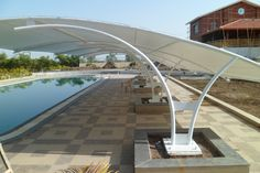 TI Tensile Structures Manufacturers world-class Tensile Structures, which are light in weight because their structural stability derived from their pre-stressed shape rather than mass of the material used. Our range of Tensile Structures is much lighter than conventional building structure and yet it offers high stability.