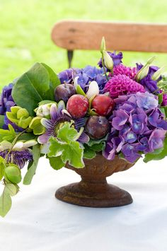 Purple & green fruit and flowers centerpiece