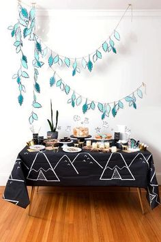 Resembling kids' chalk art of teepees lounging in the starry night, this table cover doubles as an enchanting photo backdrop. Bear Birthday, 3rd Birthday, Birthday Party Themes, Birthday Garland, Party Garland, Indian Party, Kids Party Decorations, Camping Parties, Party In A Box
